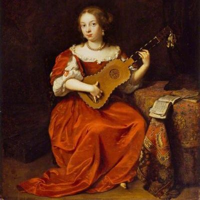 Woman playing a baroque guitar