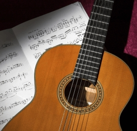 Guitar with sheet music