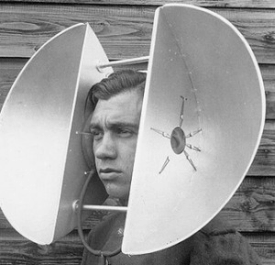 Male with ear training contraption